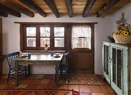 wooden beam ceiling and rustic cabinet for english cottage kitchen