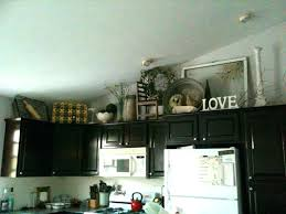 Christmas Decorating Ideas For Kitchen Cabinets by Creative Ideas For Decorating Above Kitchen Cabinets Creative