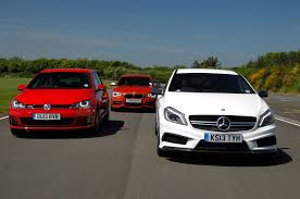 mercedes volkswagen mercedes a45 amg vs volkswagen golf gti vs bmw m135i hatch