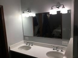 should vanity lights hang over mirror should vanity lights hang over the mirror