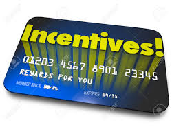 incentives word on a blue credit or gift card for rewards or
