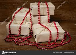 gift wrapping from kraft paper wrapped with twine u2014 stock photo