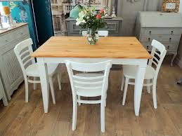 shabby chic pine dining table with four chairs in streatham