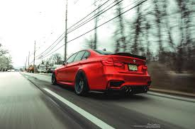 matte red bmw bmw f80 m3 yas marina bmw f80 m3 with a varis style carbon fiber
