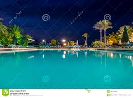 water pool at night vacation background stock photo image