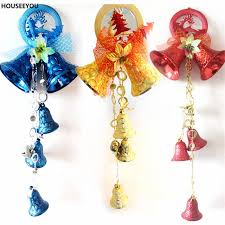 a string christmas tree decorations jingle bells red blue gold