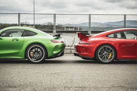 nissan gtr in snow mercedes amg gt r vs porsche 911 gt3 twin test review 2017 by