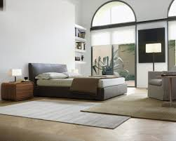 calm bedroom design with dark bed frames and head board also white author