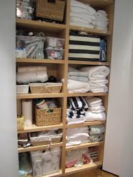 decor tips organize linen closet with wire shelving and wicker