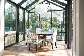 Sunroom Dining Room With Vaulted Glass Ceiling Transitional - Sunroom dining room