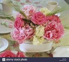Peony Floral Arrangement by Flower Arrangement Roses Peonies And Viburnum Stock Photo