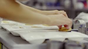 cutting and folding plates on the wedding cake stock footage video