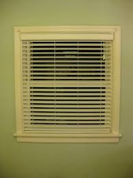 hanging some white faux wood blinds in the bedroom young house love