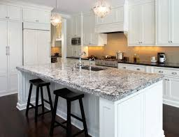 small chandelier hung over an island with quartz countertops