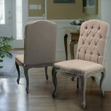 Traditional Dining Room Chairs Contemporary Living Space Featuring Beige Fabric Dining Chairs