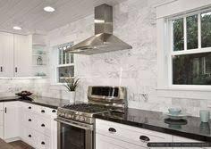 kitchen backsplash ideas with black granite countertops 1970s kitchen turned major multitasker black granite countertops