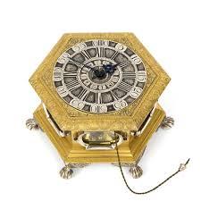German Clocks Vangoghle A German Hexagonal Gilt And Engraved Table Clock