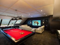 moden man cave ideas with red pool table and white sofa and big