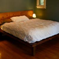 furniture brown wooden wood platform bed with rectangle hedaboard