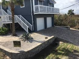 a driveway and wall done with tremron u0027s old town pavers and