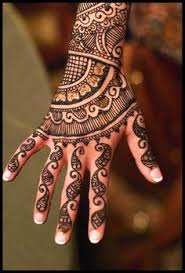 reflective mehndi or henna on the palms beautiful henna and leaves