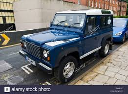 white land rover defender 90 blue 4x4 land rover defender 90 during muddy 4x4 off road