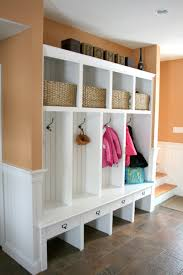 interesting entry bench with storage with hand made mudroom built