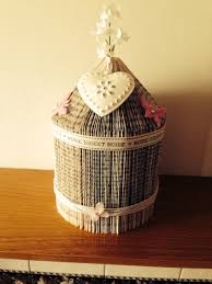 handmade bird cage made from an old book and decorated with ribbon