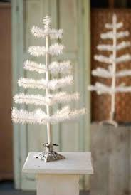 36 white feather tree and stand 85 tree toppers pyramids etc