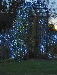 garden trellis with solar string lights using long lasting solar