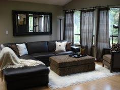 how should i decorate my living room how to decorate around the black leather couch for the home