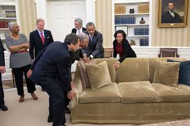 file barack obama helped to move a sofa back in place in the oval