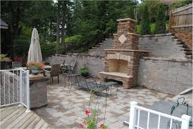 Terraced Retaining Wall Ideas by Stone Fireplace Built Into Retaining Wall Tall Wall Broken Into
