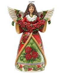 jim shore with poinsettia collectible figurine