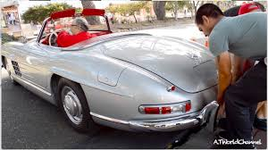two men lifting a 3 million 1955 mercedes benz 300sl roadster