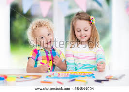 little boy draw together white stock photo 580303795