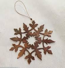 cut copper ornaments tagged snowflake
