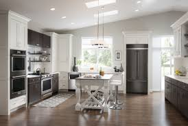 white kitchen cabinets dark grey countertops small narrow galley