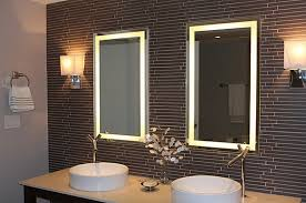 installing lighted bathroom mirror to make the bathroom sink