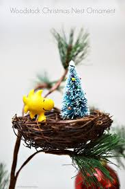 woodstock christmas nest ornament as the bunny hops