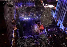 thousands attend rockefeller christmas tree lighting boston herald