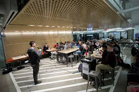 the innovation campus building better ideas new york times griffen kelly founder trac and northwestern alumnus speaks students during the weekly dinner garage which was built one