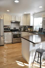 suburbs mama kitchen update one year later white cabinets and