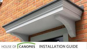 Overdoor Canopies by Fitting A Flat Roof Door Canopy Youtube