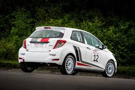 toyota rally car toyota develops affordable yaris r1a rally car