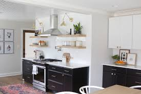 how to organize open kitchen cabinets how to style open shelves in the kitchen the diy playbook