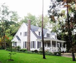 cape cod with front porch have long extended porches on both home