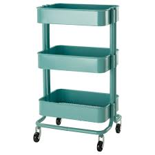 turquoise metal portable pantry cabinet on wheels with three