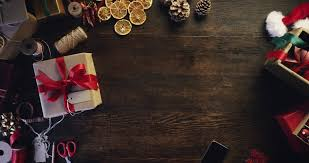 Christmas Present Table Decoration by Top View Woman Photographing Christmas Decorations Using