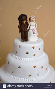 wedding cake with mixed race couple stock photo royalty free